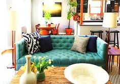 I do love turquoise with navy and orange.  The table in the back corner reads orange.  Also love this room in general