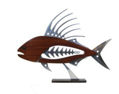 The Striper Wall Sculpture is 34 long x 15 high x 2 1/2 thick. Each sculpture is constructed of 3 layers of 3/4 birch plywood. I start by sketching the idea, then creating the design in a computer graphics program. After the pieces are rough cut, the layers are laminated together and shaped to their final contour. The fish was stained with acrylic washes and two coats of acrylic lacquer have been applied over the surface.    Plywood often contains voids in the veneers which show up ...