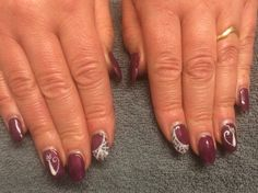 Halloween purple with cat and cobweb designs on accent fingers-Tia Dartnell's nail creations! our nail technician here at Faith hair and beauty. ❤️
