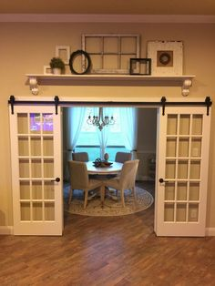 I would put some french doors on a barn door rail because it gives off a vintage look. Having the doors there will give you some privacy if you ever need it. And when the doors are open, it'll feel like there is more space in the dining room. Interior Barn Doors, Room Interior, Interior Design, Interior French Doors, French Door Decor, Contemporary Interior, Luxury Interior, Barn Door Decor, Above Door Decor