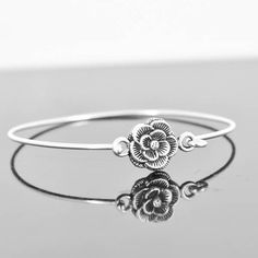 A personal favourite from my Etsy shop https://www.etsy.com/hk-en/listing/280703090/flower-rose-bangle-sterling-silver