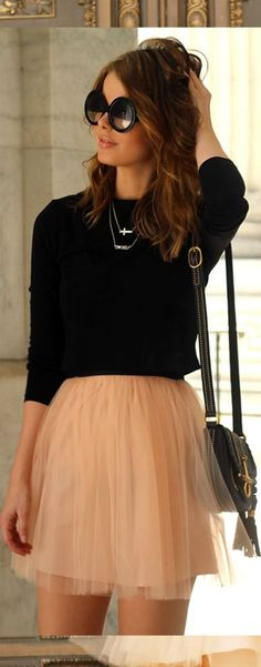 black sweater and light colored skirt