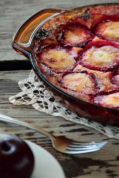 Plum Clafouti - this simple and classic French dessert is absolutely delicious. Halved plums are baked in a sweet and soft custard. Top with a scoop of ice cream or whipped cream for a perfect dessert.