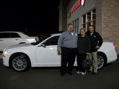 Chris & Lori with salesman Ray Marko and their new Chrysler 300!