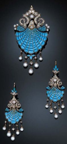 A SUITE OF ANTIQUE TURQUOISE, DIAMOND AND PEARL JEWELLERY. Comprising a pendent brooch, designed as a cabochon turquoise shield-shaped plaque suspending rose-cut diamond and pearl drops to the rose and old mine-cut diamond scrolled surmount, mounted in 18k rose gold; and a pair of ear pendants en suite, circa 1880. #antique #brooch #pendant #earrings
