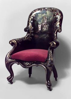 English Victorian Papier mache pearl inlaid black lacquered bergere arm chair with slip seat and decorated building scene with arches