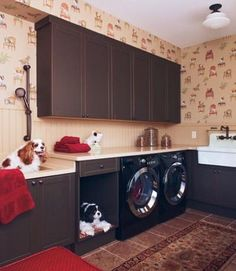 Laundry rooms are other good areas to corral pets.  This one features a bed niche alongside their bathing sink.  A doorless niche is perfect if pets don't require containment and it keeps the bed from being underfoot.  Be sure not to miss the funky dog wallpaper.
