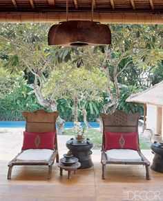 Bali outdoor - Elle Decor.  The antique Indonesian carved chaises are gorgeous. And a rain drum.