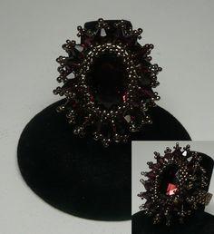 Crystal Burst Burgundy    Design by Laura McCabe       Swarovski Burgundy Oval Rivoli with Burgundy and Garnet bicones and miyuki beads