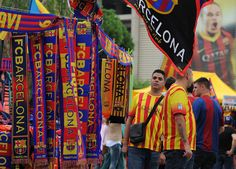 FC Barcelona scarves hang from a merchandise shop before the La Liga match between FC Barcelona and Real Madrid CF at Camp Nou stadium on October 26, 2013 in Barcelona, Catalonia.