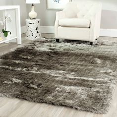 Give your interior décor a luxurious update by adding this hand-woven silver shag rug. It features a satin sheen, while providing all the comfort of soft polyester pile. The rich look of this expertly crafted piece will enliven any interior.