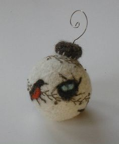 Felt Christmas ornament with felted or embroidered birds. Very nice!  @Jess Pearl Pearl Pearl Liu Johnston Thought you might get some ideas for this, it's pretty cool idea :)