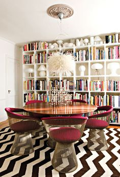 burgundy platner chairs. zig zag rug, bookshelves, chandelier pendant