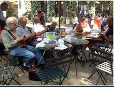 men knitting in the park … knitting lessons in  bryant park, new york city   via vogue knitting, facebook