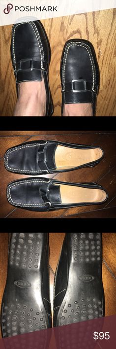 Iconic Tod's black leather Gommino Driving shoes! So cute and classic! Black leather with white stitching. Worn gently! Treated with love! Size says 7 I'm a 7.5 and they fit comfortably. Tod's Shoes Moccasins