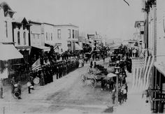 Civil War Veterans, Fourth of July or Decoration Day, Ortonville, Minnesota. On review in center of town, ca. 1880