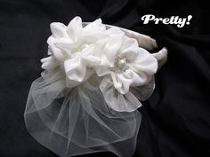 ribbon flowers on a headband--this one is for a wedding but great possibilities for other kinds.