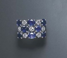 A SAPPHIRE AND DIAMOND RING, BY MICHELE DELLA VALLE The top designed as an…