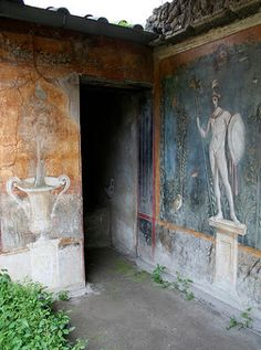 Pompeii, House of Venus in a Shell. On the rear wall of the peristyle are three large paintings on a blue background. The left hand painting is of the god Mars shown standing naked on a plinth while holding a lance & a shield. Around him the foliaged garden is teeming with bird life. AD 79 eruption