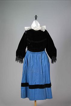 Ensemble Date: 1850–99 Culture: French (Breton) Medium: Cotton, linen, metal, metallic, silk, wood, leather, glass