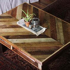 Herringbone Pallet This coffee table takes pallet furniture to the next level. After pallets have been disassembled, the wood is applied in a herringbone design to a plywood backing, which then tops another pallet. It's all mounted onto wood block legs.