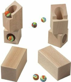 """HABA Marble Run Rotating Angles by HABA. $26.59. Materials: wood. Measurements: packaging 7.5 x 3.5 x 5 inches. Weight: 1 lb. Age: 3+. Made in Germany. HABA 3537 - These angles know the twist - they direct the tracks in any given direction. Complementary to all HABA building blocks and marble run sets. Wooden set includes two rotating angles, two rectangular blocks and six marbles. Rotating angle measures 2.5"""" tall. Recommended for 3 years and up. Made in Germany"""