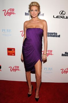 Kate Upton | February 16 2012  For a Sports Illustrated Swimsuit event in Las Vegas, she wore a strapless purple dress with black stiletto heels.