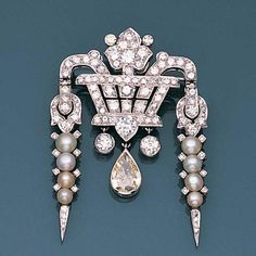 An art deco diamond and seed pearl giardinetto brooch, circa 1925 The highly stylised basket of flowers set with single and brilliant-cut diamonds, issuing two seed pearl pampilles, with a central pear-shaped diamond drop, principal diamond approximately 0.60 carat, length 4.5cm.
