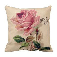 A feminine vintage pink rose pillow with a stylish beige background.