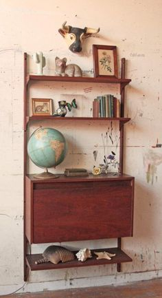 Wall-mounted drop-front mid-century desk & shelves.