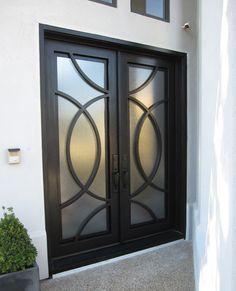 Designer Iron Entry With Unique Round Iron Design Double Doors