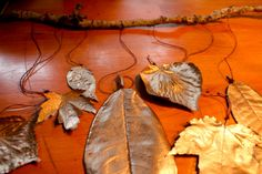 How to make a fall mobile by spray-painting leaves.