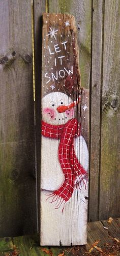 This is a great old piece of barn wood on which Ive painted this primitive snowman. Ive added Let It Snow at the top. The piece measures 39
