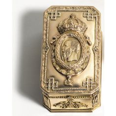 A rare Mexican Imperial Presentation gold snuff box circa 1865.  Rectangular with cut corners, the lid applied in high relief with a portrait in profile to dexter of Emperor Maximilian of Mexico within a laurel garland and the chain of the Order of the Mexican Eagle, instituted by Maximilian in 1865, below the Imperial crown, ropework and acanthus borders, the sides applied with beading a nd scrolled flourishes.
