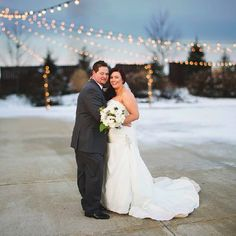 Check out this snowy winter wedding from Violet Short Photography featuring navy blue touches in the decor, dresses & flowers.