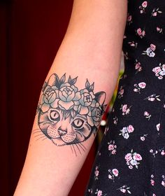 A cat with a flower crown for a tattoo? Yes, please.
