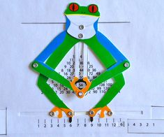 Practice your multiplication table with this mechanical calculator. You can download the template to make your own smart little frog with a sheet of paper.