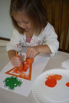 Pencils, Proverbs, Pandemonium, & Pins: The Carrot Seed.  Stamping carrot tops in orange paint.