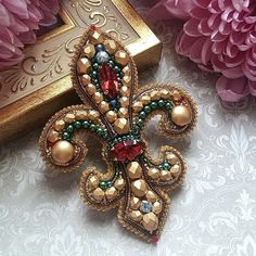 Beading is among the most popular specific niches in precious jewelry making and rightfully so. It takes a great deal of skills and perseverance in order to make intricate and innovative pieces from simply a lot of beads and string. Bead Embroidery Patterns, Couture Embroidery, Bead Embroidery Jewelry, Soutache Jewelry, Beaded Embroidery, Beading Patterns, Hand Embroidery, Embroidery Designs, Beaded Jewelry