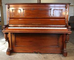 An 1890, Bechstein Model III Upright Piano For Sale with a French Style, Walnut Case with Claw Foot legs at Besbrode Pianos