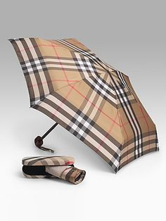 Who needs to look for the silver lining when there is a nova check one? Love my Burberry umbrella it makes the rain more bearable