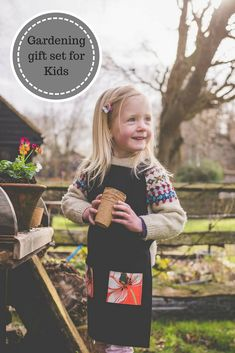 Gardening gift set for children. Includes handmade apron, biodegradable pots, seeds and wildflower paper. Sustainable, thoughtful gift for children.