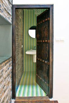 Antique doors are juxtaposed against vibrant yellow and green tile. Neutral Bathroom Tile, Bathroom Tile Designs, Modern Bathroom Design, Small Bathroom, Green Countertops, Rustic Italian, Antique Doors, Interior Decorating, Interior Design