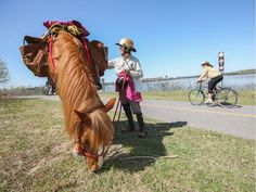 Megan Lewis and her horse Lady on the NCC pathway beside the Ottawa River. Lewis is riding across North America to raise money for Challenge Aid.
