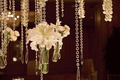 These hanging crystals and flowers add romance and a touch of elegance to any wedding reception.