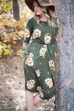 This floral print midi dress in olive is one of our favorites this season!  Pairs nicely with your favorite booties or heels. Full-length sleeve Cinched waistli