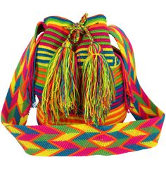 Each PUTCHIPUU Bag is handmade by the women of the WAYUU Tribe located in the northern peninsula of Colombia in a rural area called La Guajira. One bag can take up to 20 days to make and the design is