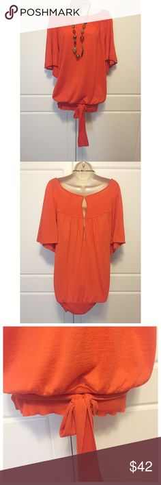 """DVF Orange Wool Bottom Tie Blouson Top Short, flowy sleeves, 100% merino wool top in bright orange by Diane von Furstenberg. Blouson shape with sash on bottom that wraps back to front and ties. Boat neck with subtle ribbing in front at shoulders and on bottom band. Back is partially open between two button closures. Measurements: bust 17"""", length 29.5, across back 14"""". Diane von Furstenberg Tops Blouses"""