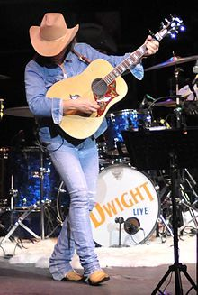 Dwight David Yoakam (born October 23, 1956) is an American singer-songwriter, actor and film director, most famous for his pioneering country music. Popular since the early 1980s, he has recorded more than twenty-one albums and compilations, charted more than thirty singles on the Billboard Hot Country Songs charts, and sold more than 25 million records.