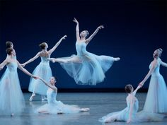 """Sara Mearns, center, and Company in George Balanchine's """"Serenade."""" Photograph by Paul Kolnik."""
